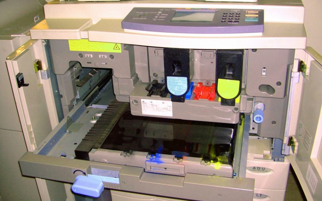 A look the inside of a printer getting maintenance done