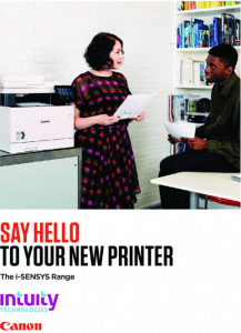 Small Canon office printer in use.